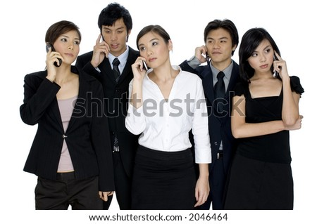 Five young asian businessmen and women all having different conversations on mobile phones