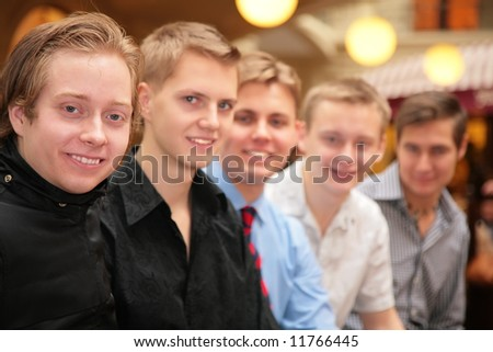 five young men indoor