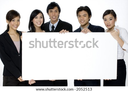 Five young professionals holding a large blank sign