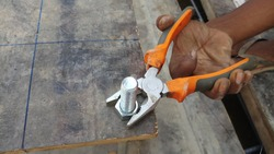 Fixing of anchor bolt to the template using  pliers.Hand and plier.