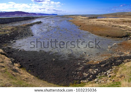 Fjord at Low Tide:  The shallow bottom at the end of an Icelandic fjord is visible between tides.