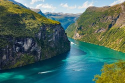 Fjord Geirangerfjord with ferry boats, view from Ornesvingen viewing point, Norway. Travel destination