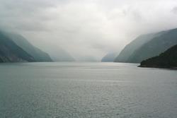 fjord in fog in the arctic ocean