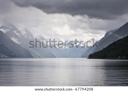 Fjord landscape white low clouds