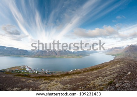 fjord surrounded by beautiful mountains bathing in evening light