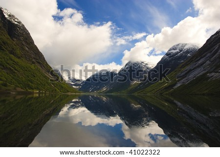 Fjords of Norway with snowy peaks - stock photo