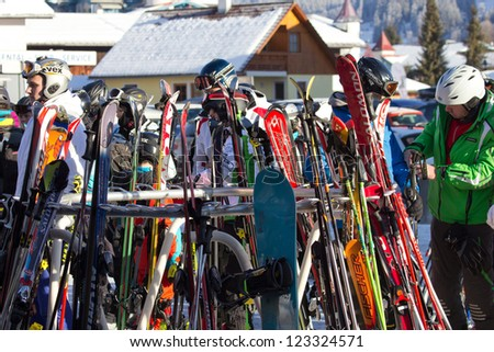 FLACHAU, AUSTRIA - DEC 29: People at the ski pistes in the ski resort town of Flachau, Austria on Dec 29, 2012. These pistes are part of the Ski Armada network, the largest of Europe.