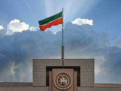 Flag and and coat of arms of the Tatarstan Republic on the top of building