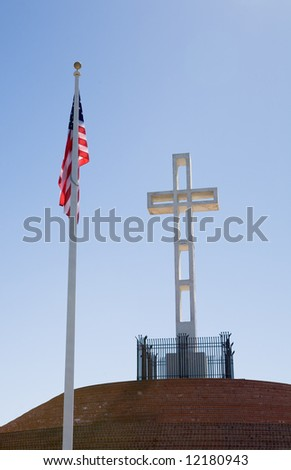 Flag and cross dedicated to veterans of American wars on top of Mount Soledad in La Jolla California