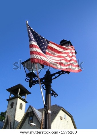 Flag and Lamp Post in Small Town USA