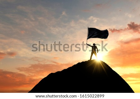 Flag being waved at the top of a mountain summit. 3D Rendering Stock photo ©
