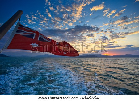 Flag Flying from boat in Cairns Harbor at Sunrise