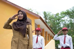 Flag honor is performed by teacher and students ceremonial flag raising in indonesia