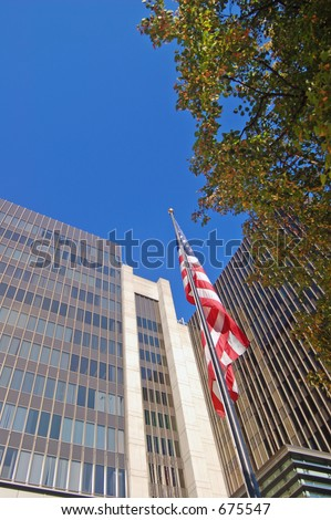 Flag in front of some corporate office buildings in downtown Sacramento, California