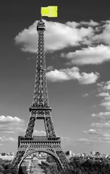 flag like a jackets symbol of Yellow vests movement on Eiffel Tower in Paris seen from the Trocadero in black and White effect