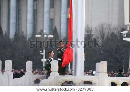 Flag Lowering Ceremony At Beijing Tian'anmen Square.