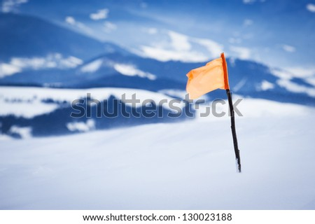 flag marker on the top of the mountain