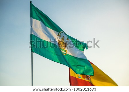 Flag of Andalusia under a blue sky - Andalusia autonomous community - Andalusia waving flag photography Stock fotó ©
