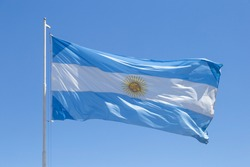Flag of Argentina. Argentine flag against a blue sky