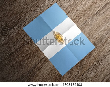 Flag of Argentina on paper. Argentina Flag on wooden table. #1503169403