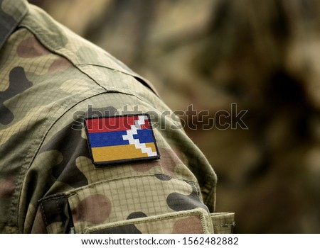 Flag of Artsakh on military uniform. Flag of the Republic of Artsakh and also known as Nagorno-Karabakh Republic on soldiers arm. Army, armed forces, soldiers. Collage.
