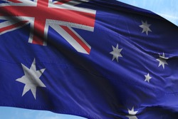 Flag of Australia fabric waving in the blue sky. National Flag of Australia for Independence day.