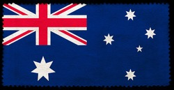 Flag of Australia on the old grunge postage stamp isolated on black background. Texture of old paper. 3D illustration
