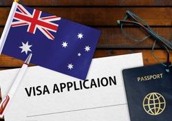 Flag of Australia , visa application form and passport on table