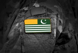 Flag of Azad Kashmir on soldiers arm. Flag of Azad Jammu and Kashmir on military uniform (collage).