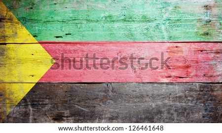 Flag of Azawad painted on grungy wood plank background