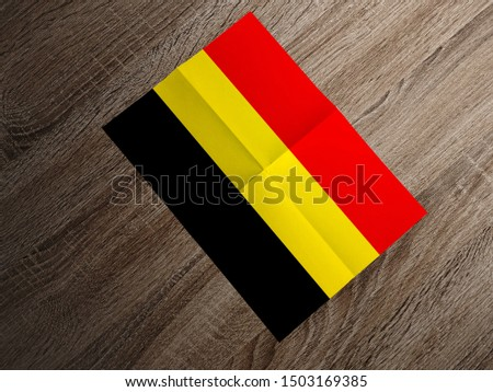 Flag of Belgium on paper. Belgium Flag on wooden table. #1503169385