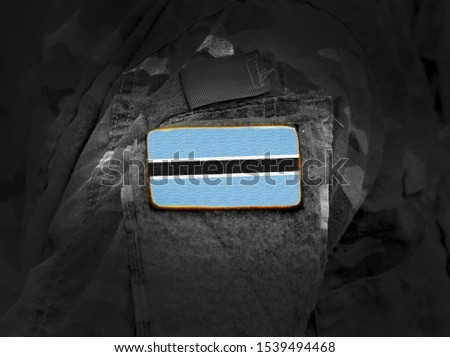 Flag of Botswana on military uniform. Army, troops, soldiers, Africa,(collage).