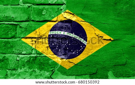 Flag of Brazil against a brick wall. #680150392