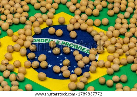 Flag of Brazil covered in soybeans. Concept of South America agricultural imports, exports, trade, trade war, tariffs, production and commodity markets
