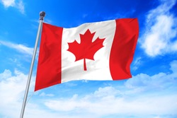 Flag of Canada developing against a clear blue sky