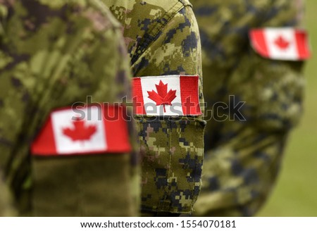 Flag of Canada on military uniform. Canadian soldiers. Army of Canada. Remembrance Day. Canada Day. Photo stock ©