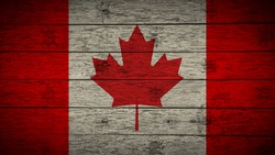 Flag of Canada Painted on old wood boards. wooden Canada flag. Abstract flag background for your text or logo. grunge Canadian flag.