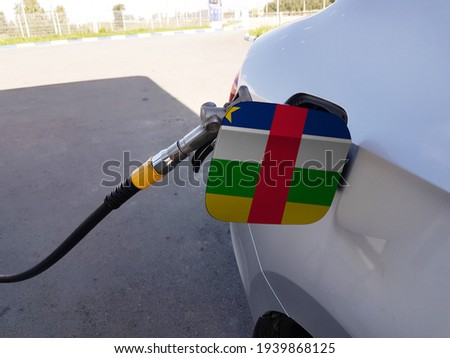 Flag of Central African Republic on the car's fuel tank filler flap. Petrol station. Fueling car at a gas station. Сток-фото ©