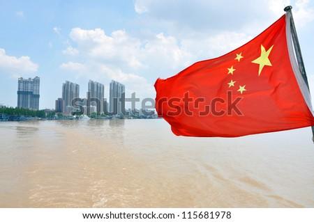 Flag of China on the Yangtze River in Nanjing, Jiangsu Province, China.