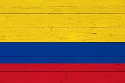 Flag of Colombia on wooden background