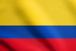 Flag of Colombia waving in the wind with detailed fabric texture. Colombian national flag.