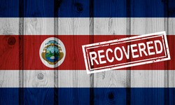 flag of Costa Rica that survived or recovered from the infections of corona virus epidemic or coronavirus. Grunge flag with stamp Recovered
