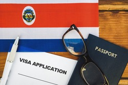 Flag of Costa Rica , visa application form and passport on table