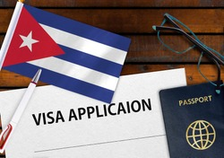 Flag of Cuba , visa application form and passport on table