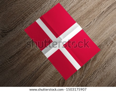 Flag of Denmark on paper. Denmark Flag on wooden table. #1503175907