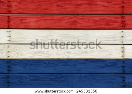 Flag of Dutch Painted on Wooden Planks.  White, Blue And Red Colors.