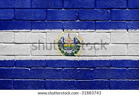 Flag of El Salvador painted onto a grunge brick wall