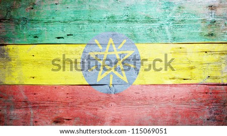 Flag of Ethiopia painted on grungy wood plank background