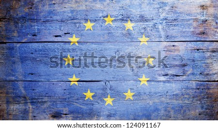 Flag of Europe painted on grungy wood plank background