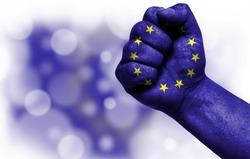 Flag of European Union painted on male fist